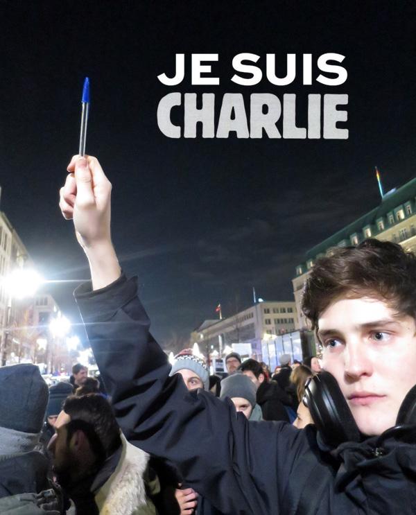 Wir machen weiter! Mika, Zeichner aus Paris, am 7. Januar vor der Französischen Botschaft in Berlin.